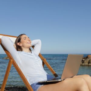 lady on beach with laptop