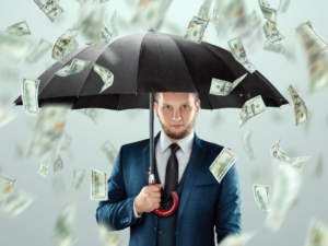man holding umbrella while it's raning money